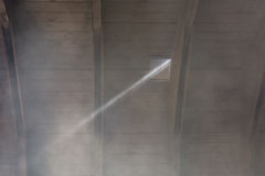 A beam of light shining through a hole in the roof Royalty Free Stock Photo