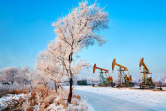 The beam pumping units and rime trees Stock Photos