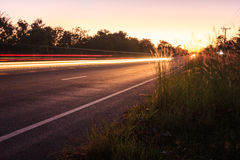 Beam of speed. Driveway at night and beam in countryside road royalty free stock image
