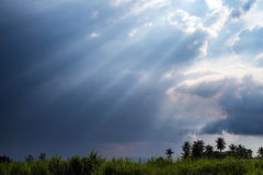 Beam of Sunlight behind the clouds Royalty Free Stock Photography