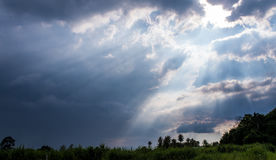 Beam of Sunlight behind dark clouds. In the countryside Stock Photography