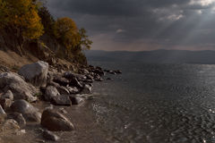 A beam of sunlight falling on the surface of the lake. Royalty Free Stock Photography