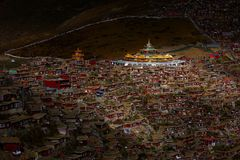 Golden Buddha-hall and red cabins royalty free stock photography