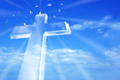 Beaming bright cross in heaven Stock Photo