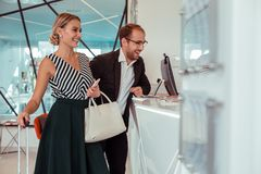 Free Beaming Good-looking Couple Staying On The Reception Desk Royalty Free Stock Photos - 152970298