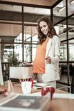 Beaming good-looking pregnant woman having wide smile stock images