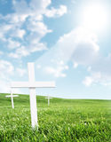 Beaming lights from heaven. 3d white crosses in open field with light beaming from heaven onto the main cross Stock Images