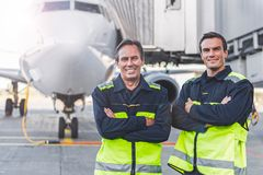 Beaming workers having job at airdrome Stock Photography