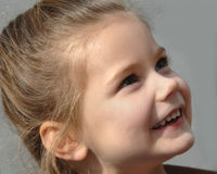 Beaming Young Girl Royalty Free Stock Photos