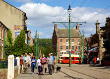 Beamish High Street. BEAMISH, UK - NOVEMBER 27, 2012: Tourists, tramlines and an old tram in the high street of the Edwardian town that forms part of Beamish Stock Images