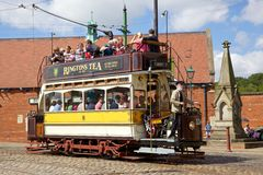 Beamish Tram. BEAMISH, UK - JULY 27, 2012: 'Newcastle 114', a tram built in 1901, trundles down the high street of the Edwardian town that forms part of Beamish Stock Image