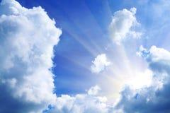 Beams through clouds Stock Photos