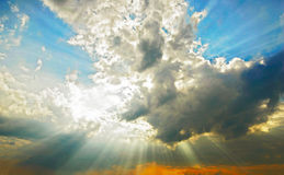 Beams through clouds. Beams of the sun make the way through clouds stock photo