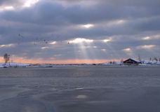 Beams Through Clouds. The winter landscape, frozen sea Royalty Free Stock Images