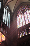Beams of light. In Cologne cathedral as the sun shines through the glass window Royalty Free Stock Images