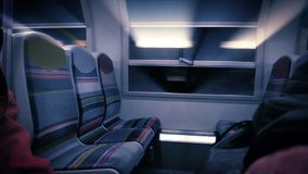 Beams of light coming through the train metro window. Cinematic scene traveling at night in fast train metro with iridescent beams of light coming through the stock footage