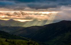 Beams of light over the mountains. Beautiful landscape in stormy weather stock photography