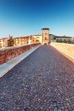 Beams morning sun bridge Ponto Pietra river Adige Italy Verona Royalty Free Stock Image