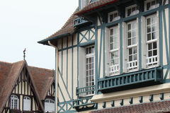 Beams painted in blue decorate the facade of a house situated in Deauville (France). Beams painted in blue decorate the facade of a house situated in Deauville stock photography