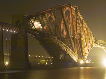 Beams and Scaffold. The Forth Rail bridge, Edinburgh, Scotland at night. Forth road bridge in the background royalty free stock photography