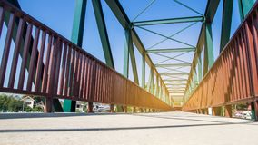 Beams of the steel bridge construction on the blue sky background,metal framework of the structure royalty free stock image