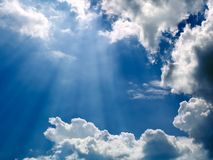Beams of sunlight. Bursting through the clouds stock photos