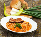 Bean with bacon. Cooked beans with bacon and vegetables,vintage Stock Photography