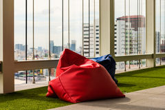 Bean bag. On artificial grass in relax zone , office building stock image