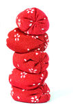 Bean Bag Column. Tiny Japanese bean bag ornaments and toy stacked into a column stock photography