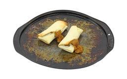 Bean and cheese burritos on baking pan Stock Image