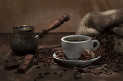 Bean coffee. Cup of coffee beans boiled in the coffee with chocolate and cinnamon sticks Stock Images