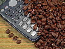 Bean Counter. Coffee Beans with a calculator, being accounted for (concept for accountants, financial advisors, etc Stock Photo