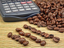 Bean Counter. Coffee Beans with a calculator, or in rows, being accounted for (concept for accountants, financial advisors, etc Stock Photos