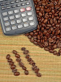 Bean Counter. Coffee Beans with a calculator, or in rows, being accounted for (concept for accountants, financial advisors, etc Royalty Free Stock Photo