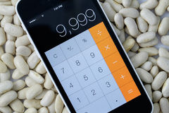 Bean counter. Calculator and beans Royalty Free Stock Photos