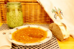 Bean dish with sausage and homemade bread Royalty Free Stock Image
