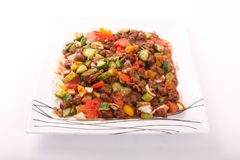 Bean Egyptian meal. Egyptian meal beans are served with tomatoes, cucumber, pepper and onions Royalty Free Stock Photos