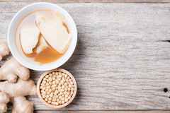 Bean junket eaten hot with gingered syrup, Soy custard Royalty Free Stock Photos