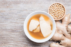 Bean junket eaten hot with gingered syrup, Soy custard Stock Photos