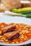 Bean meal. Cooked beans with bacon and vegetables Royalty Free Stock Image