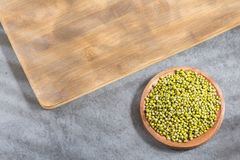 Bean Mung variety of beans in green color - Vigna radiata. Mung beans in the wooden bowl - Vigna radiata royalty free stock photography