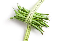 Bean pods with measuring tape Stock Images