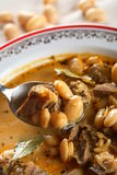 Bean with pork. Warm bean soup  with pork spiced bay leaf Stock Image