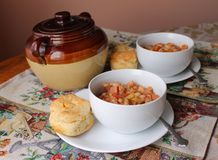 Bean pot and bowls. A hot lunch for the holidays Stock Image