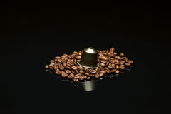 Bean's coffee cup with capsule Royalty Free Stock Image