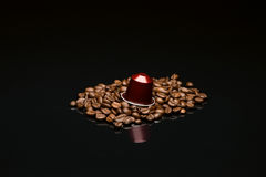 Bean's coffee cup with capsule Royalty Free Stock Photo