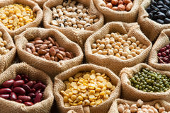 Bean seed in linen sack. Colorful Bean seed in linen sack with wooden spoon Stock Image