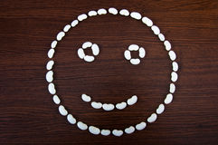 Bean smiley. A lot of bean arranged on a wooden table to look like a smiley Royalty Free Stock Photos