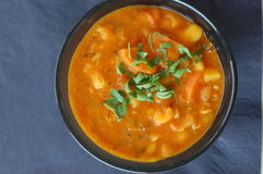 Bean soup in black bowl Stock Image