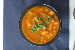 Bean soup in black bowl Stock Images